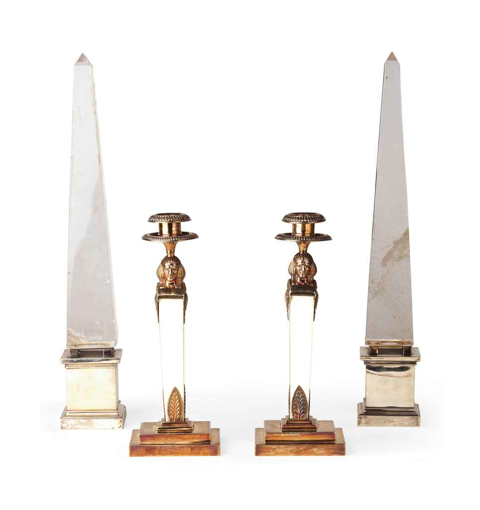 A pair of German silver-gilt and ivory candlesticks