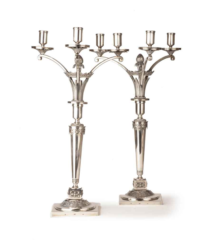 A pair of German silver three-light candelabra