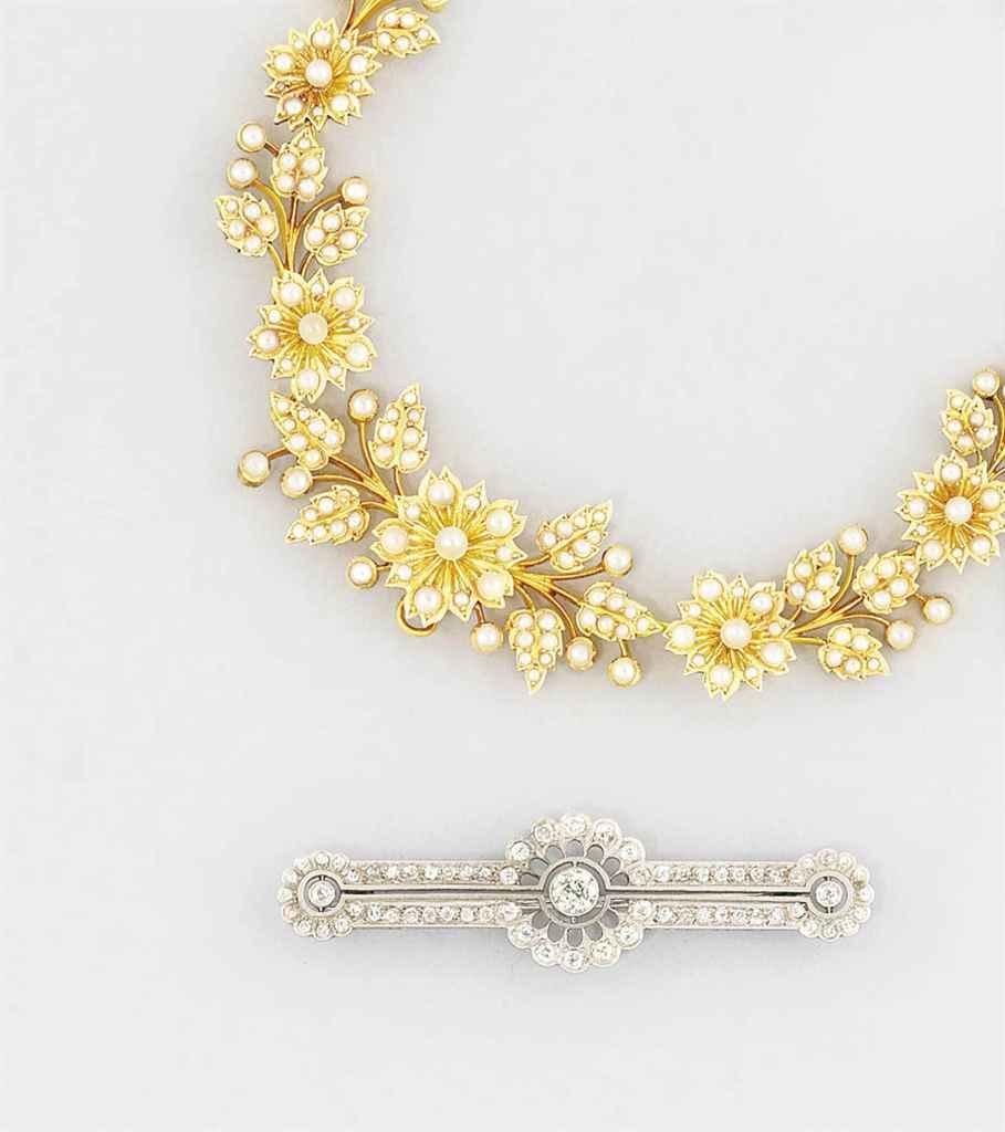 A diamond brooch and a half-pe