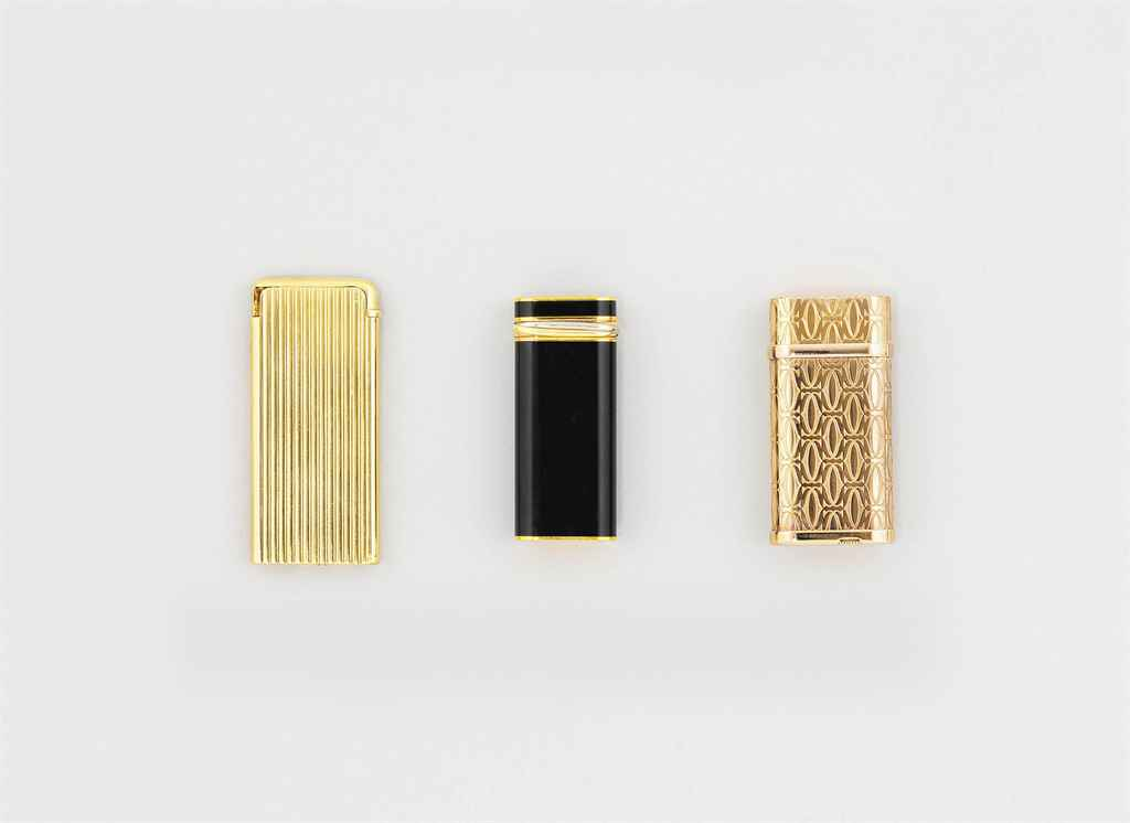 Two gilt lighters, by Cartier