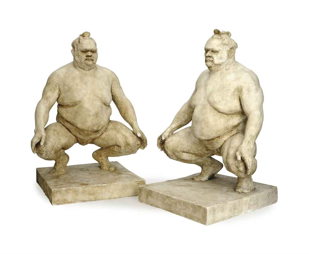 A PAIR OF PLASTER FIGURES OF CROUCHING SUMO WRESTLERS