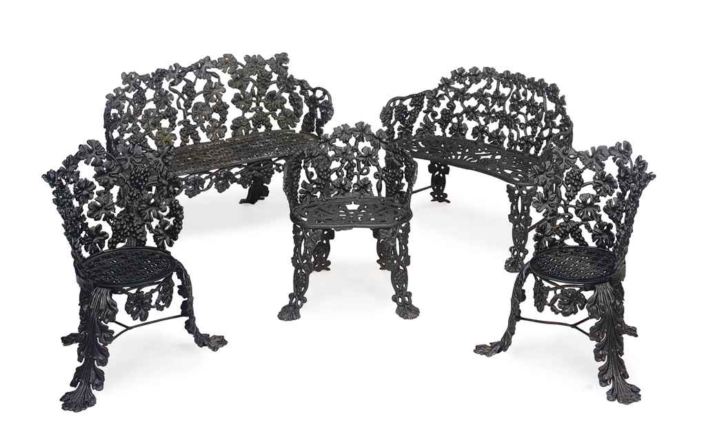 A suite of five black painted cast iron garden furniture Cast iron garden furniture