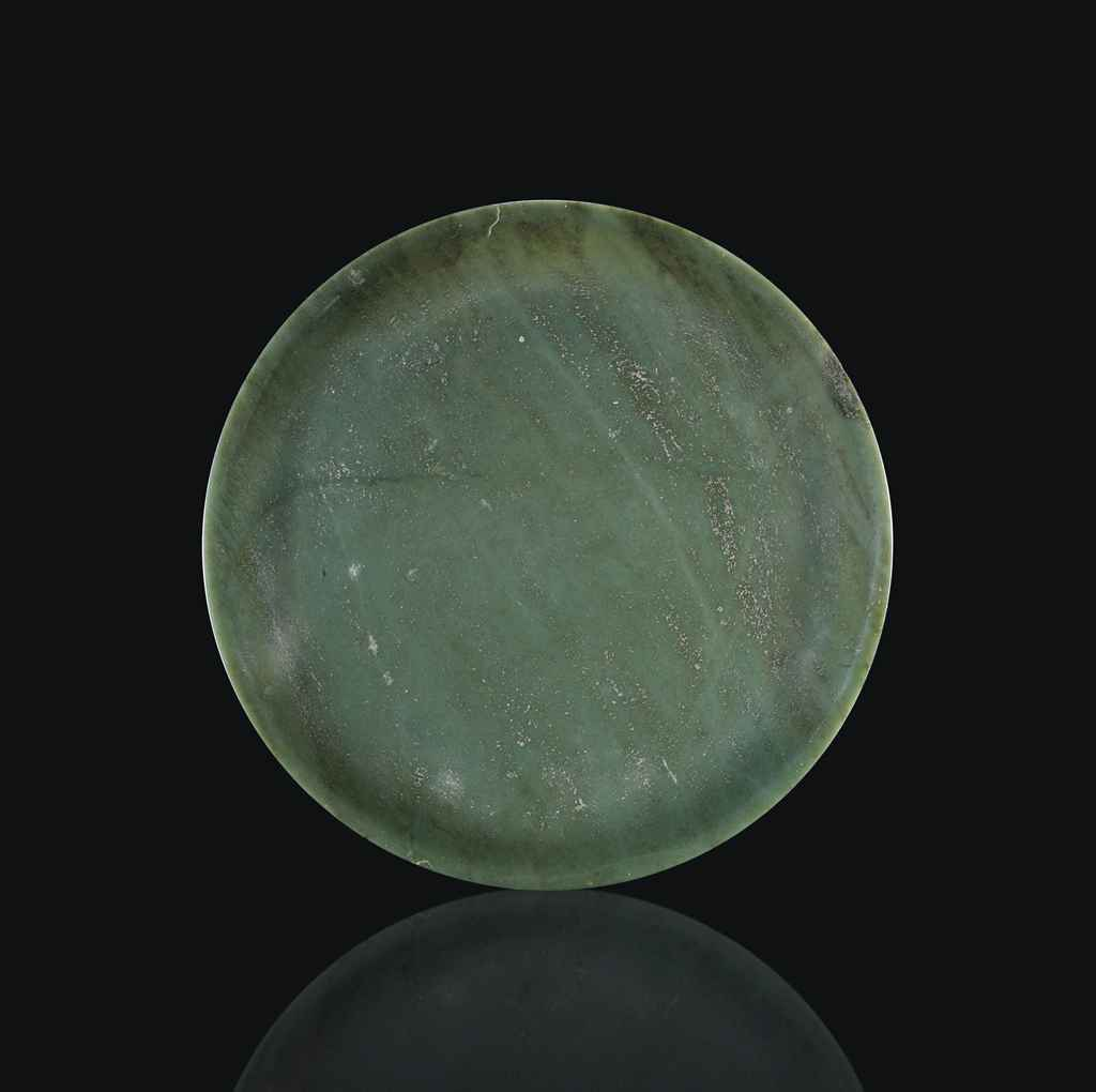 A LARGE SPINACH GREEN JADE DISH