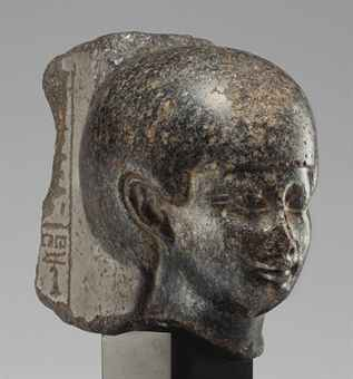 AN EGYPTIAN GRANITE HEAD OF A WOMAN