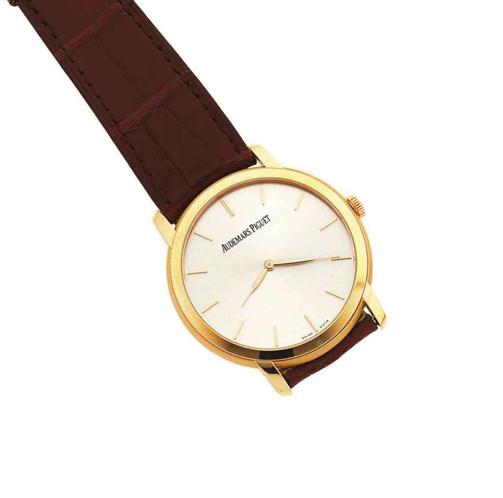 An 18ct pink gold automatic