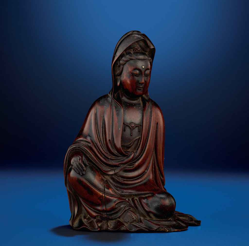 A CARVED BOXWOOD FIGURE OF GUANYIN