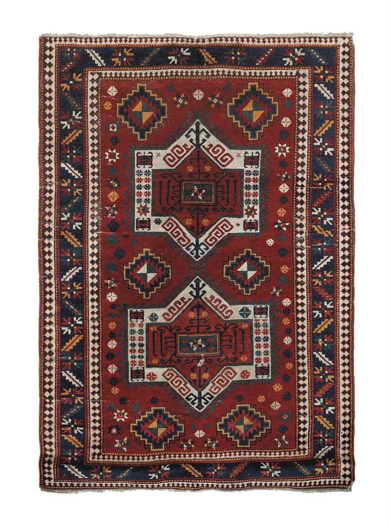 An antique Kazak Fachralo large rug