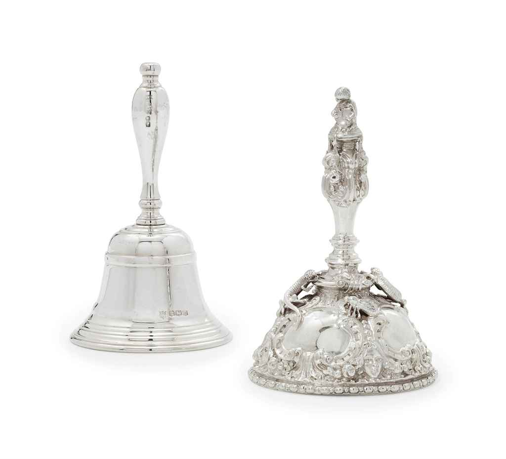 AN ELIZABETH II SILVER TABLE-BELL AND A GEORGE V SILVER TABL...