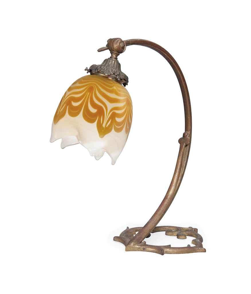 AN ART NOUVEAU BRASS TABLE LAMP WITH LOETZ IRIDESCENT GLASS SHADE ...:AN ART NOUVEAU BRASS TABLE LAM,Lighting
