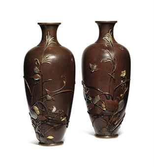 A pair of soft-metal-decorated bronze vases