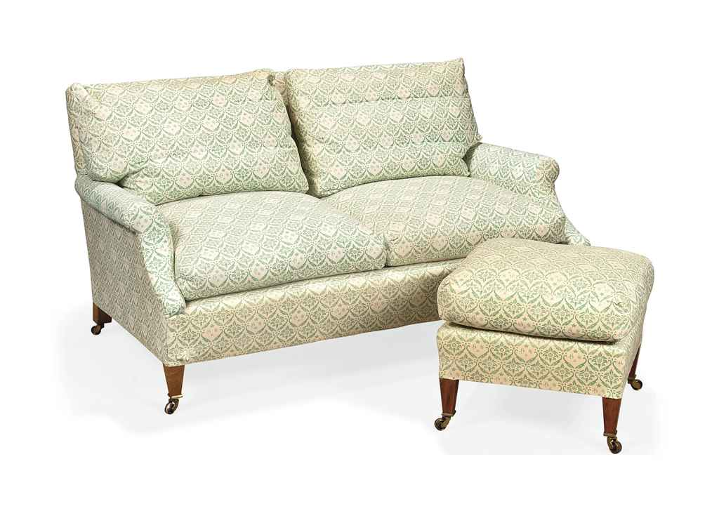 A HOWARD SOFA AND FOOT STOOL EN SUITE , BY LENYGON& MORANT LTD, MID 20TH CENTURY Christie's