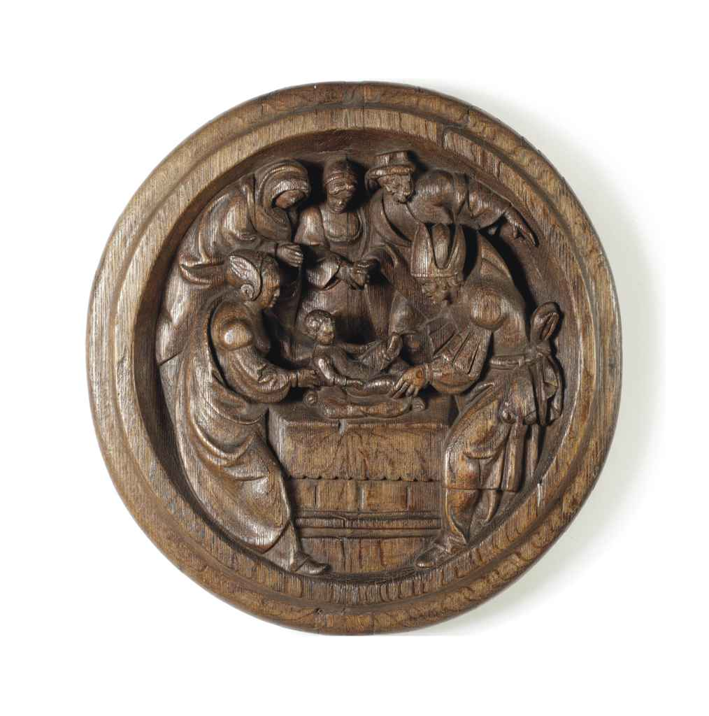A carved oak relief tondo of the circumcision christ