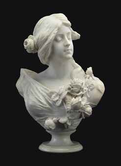 AN ITALIAN WHITE MARBLE BUST OF A MAIDEN