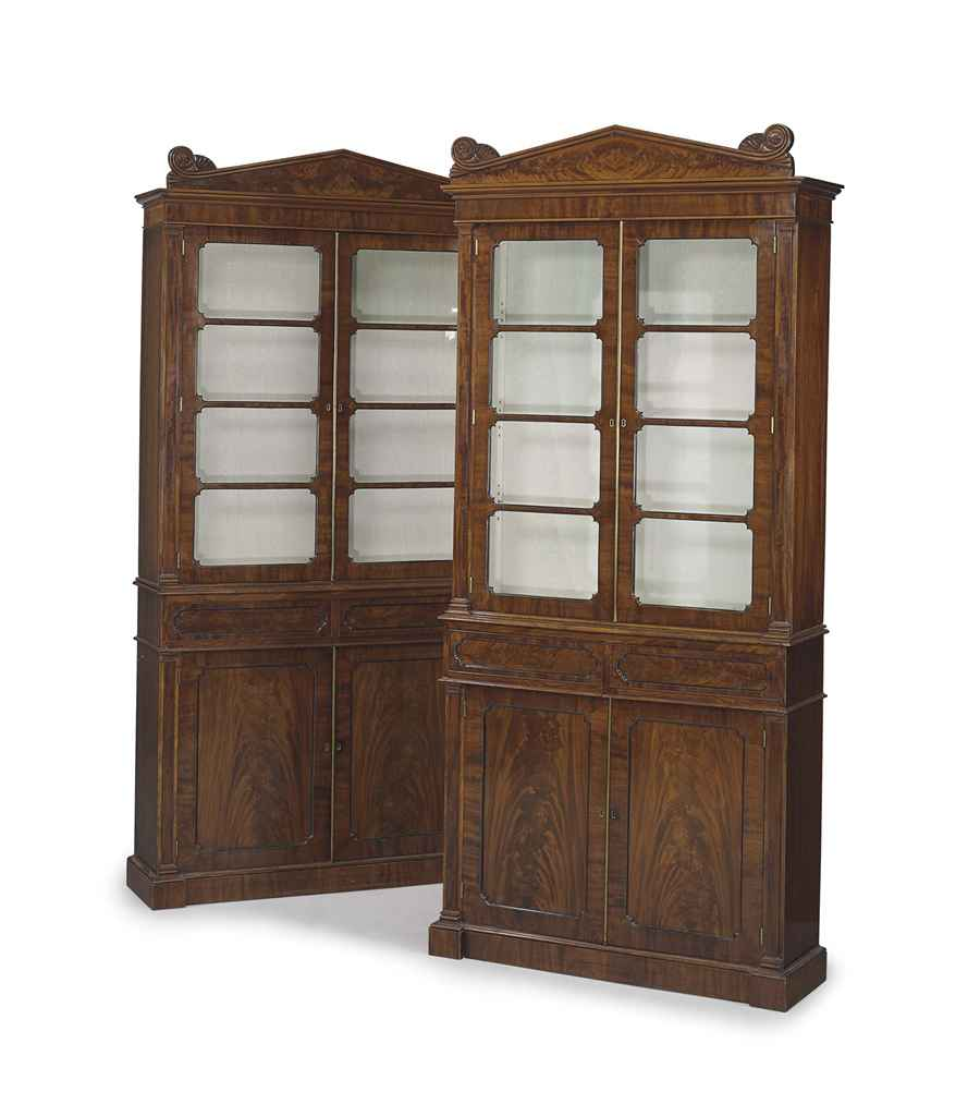 A NEAR PAIR OF REGENCY MAHOGANY BOOKCASE-CABINETS