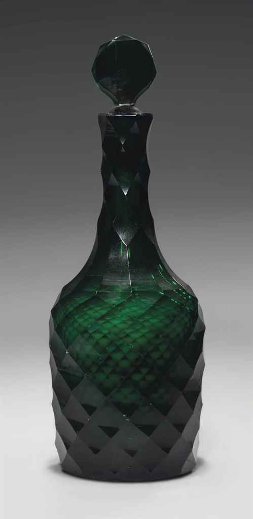 A CUT GREEN GLASS DECANTER AND