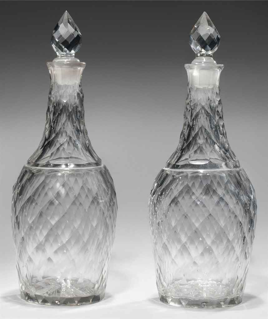 A PAIR OF CUT DECANTERS AND ST