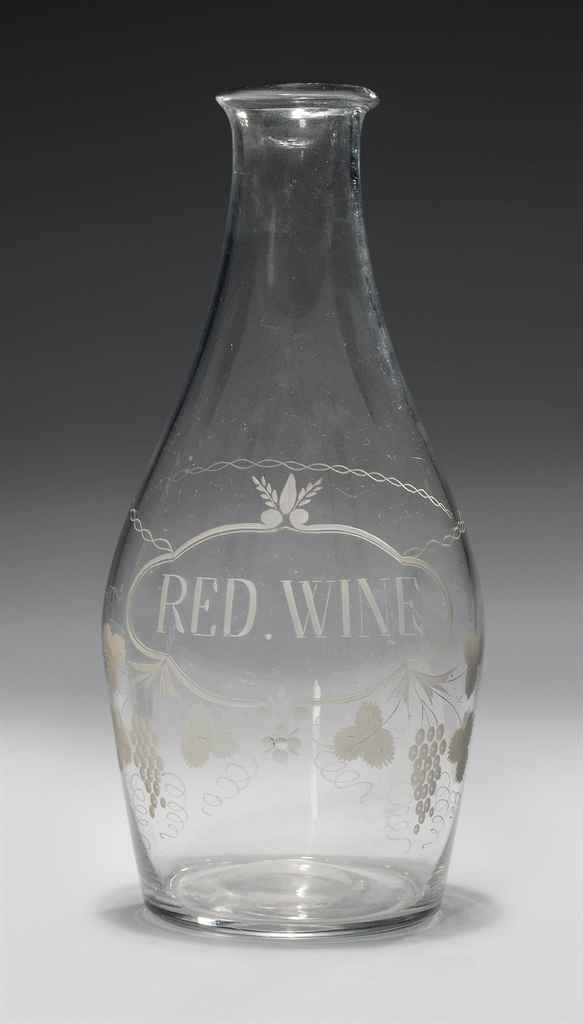 AN ENGRAVED GLASS LARGE RED WI