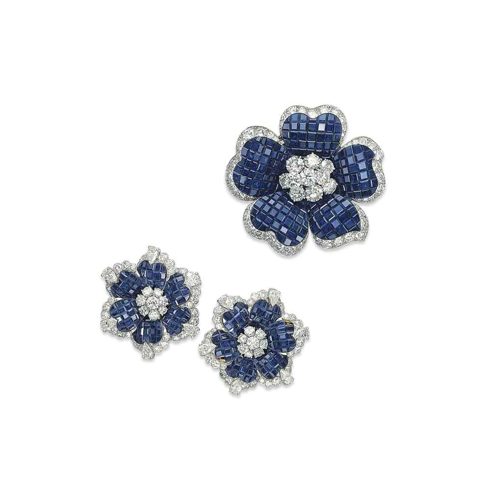 A GROUP OF SAPPHIRE AND DIAMOND FLOWER JEWELLERY BY VAN CLEEF & ARPELS