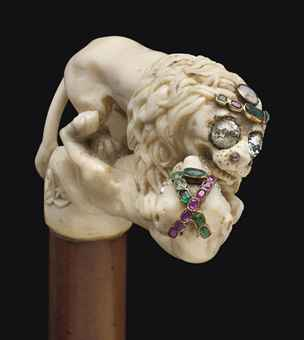 AN ANGLO-INDIAN IVORY AND MULTI-GEM ANIMAL CANE