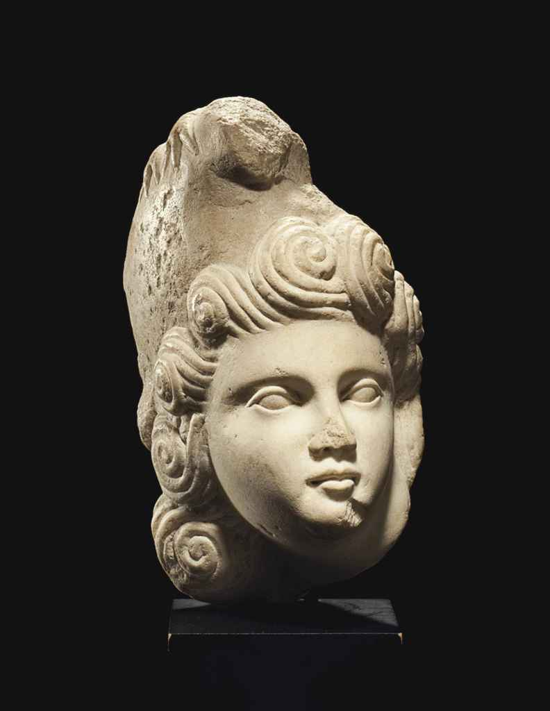 A ROMAN MARBLE HEAD OF A YOUTH