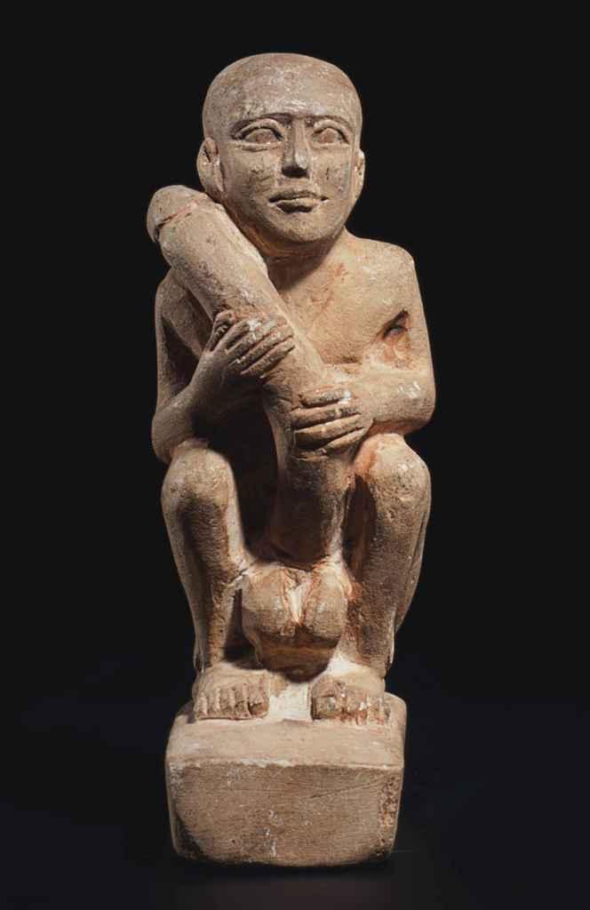 AN EGYPTIAN LIMESTONE EROTICON