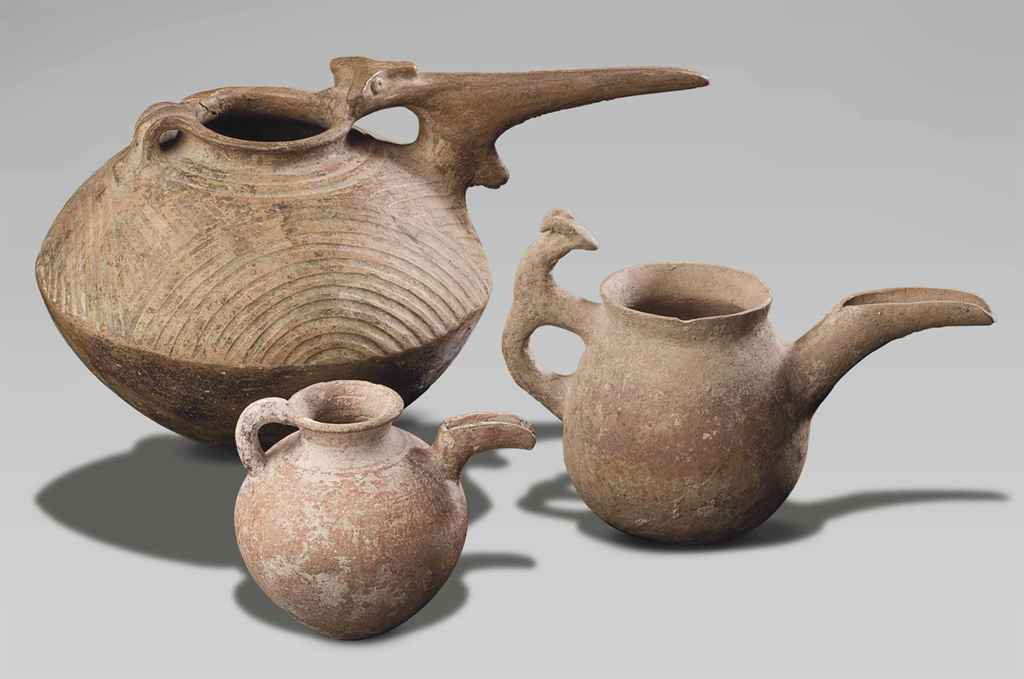 THREE IRANIAN POTTERY SPOUTED