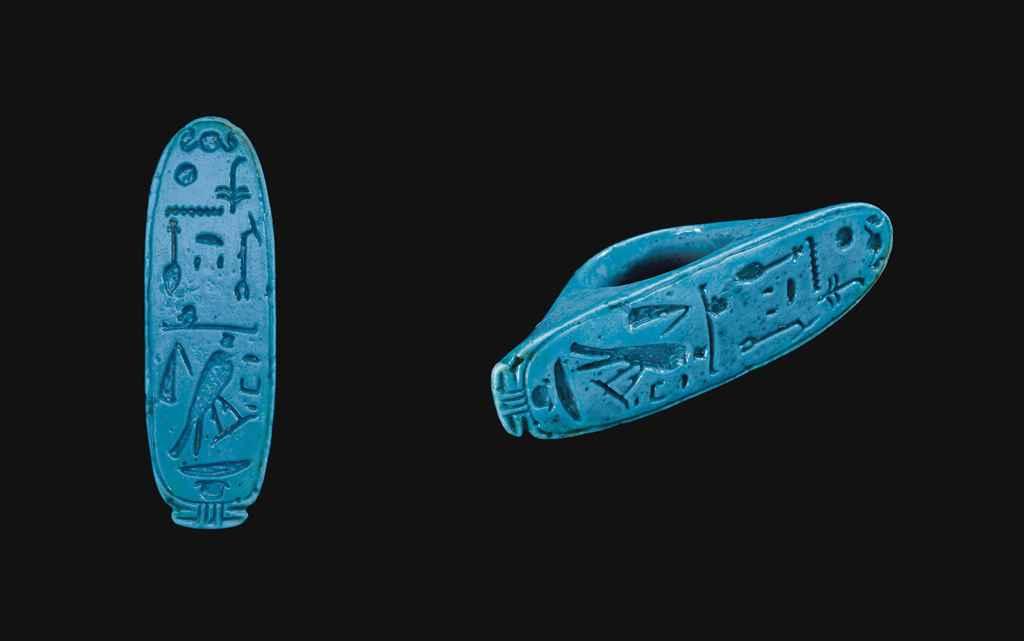 AN EGYPTIAN FAIENCE FINGER RIN