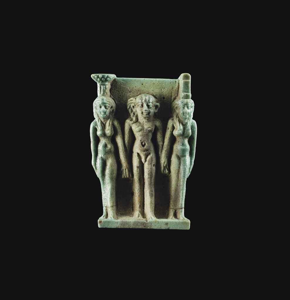 AN EGYPTIAN FAIENCE TRIAD AMUL