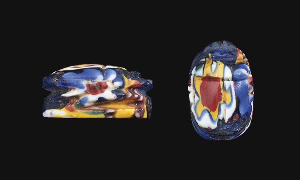 AN EGYPTIAN MOSAIC GLASS SCARA