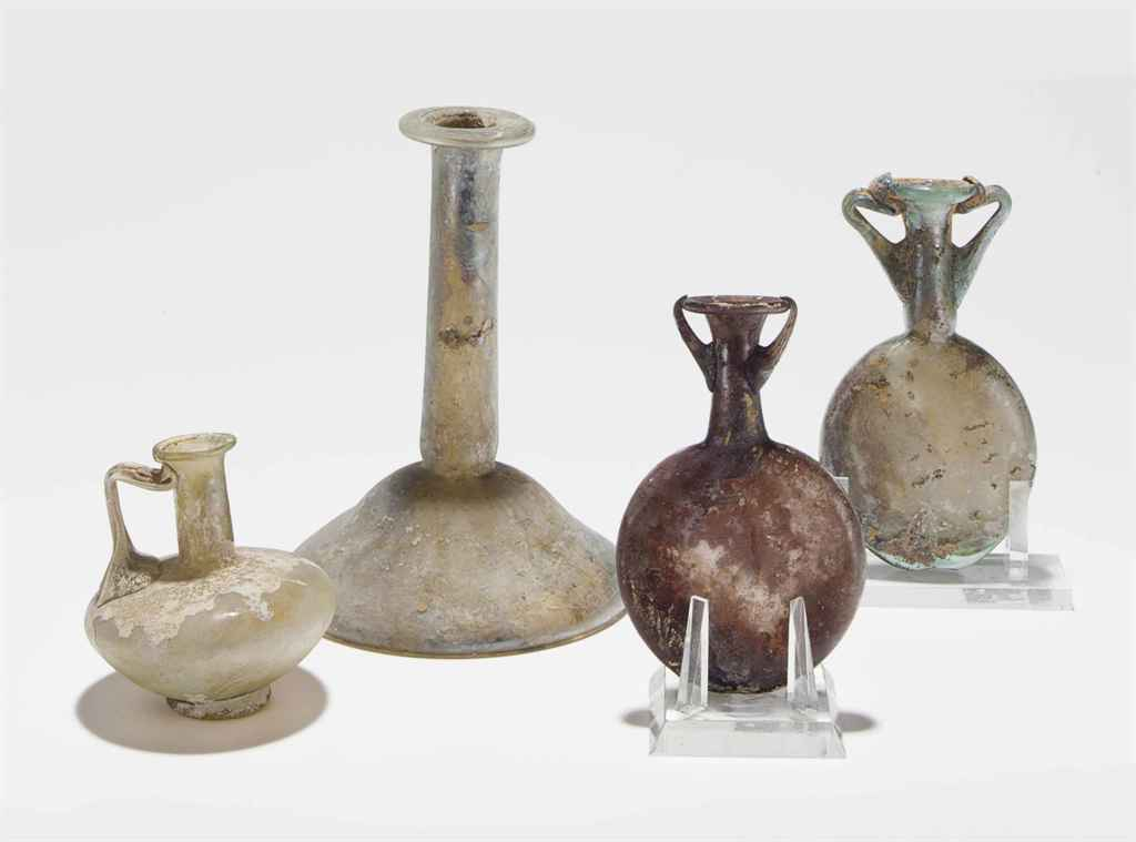 FOUR ROMAN GLASS VESSELS