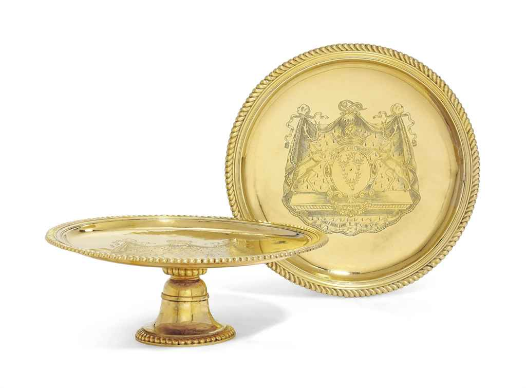 AN IMPORTANT PAIR OF WILLIAM AND MARY SILVER-GILT SALVERS