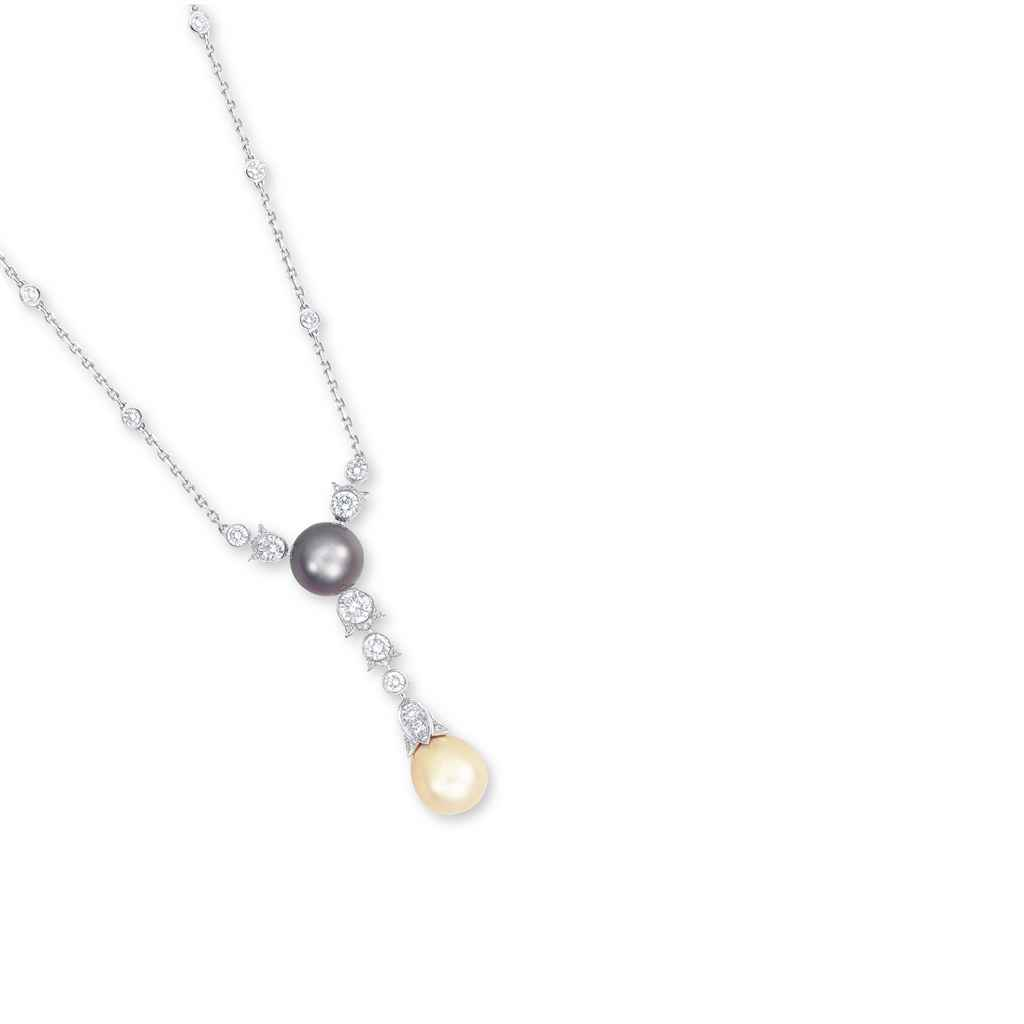 A CULTURED PEARL AND DIAMOND P