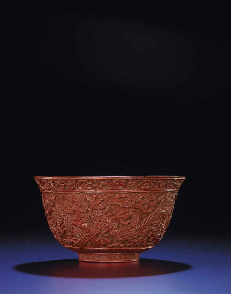 A RARE AND FINELY CARVED CINNABAR LACQUER 'DRAGON' BOWL