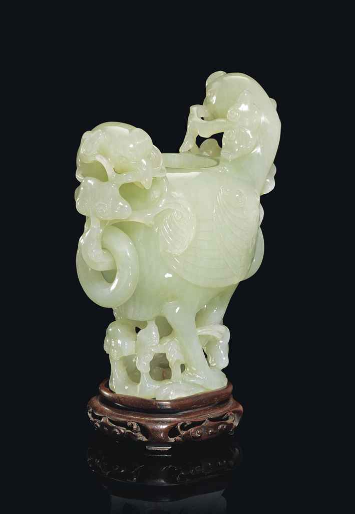 A CHINESE PALE CELADON JADE 'D