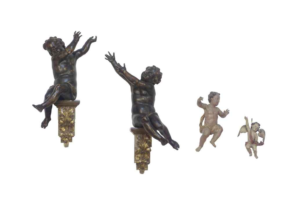 A PAIR OF CARVED AND STAINED WOOD FIGURES OF PUTTI, AND A PO...