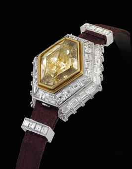 PIAGET. A LADY'S MAGNIFICENT, IMPRESSIVE, VERY RARE AND POSSIBLY UNIQUE 18K WHITE GOLD AND DIAMOND-SET HEXAGONAL WRISTWATCH WITH BROWN DIAMOND-SET CONCEALED DIAL