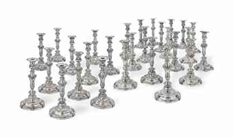 a suite of twenty-eight louis xv silver candlesticks