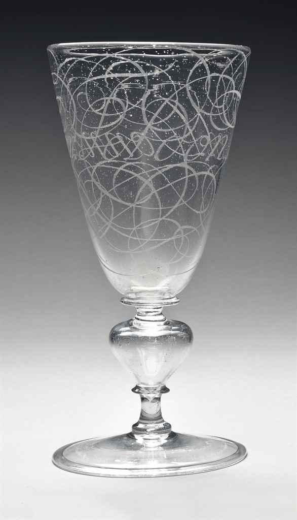 A FAÇON-DE-VENISE GLASS CALLIGRAPHIC GOBLET BY WILLEM VAN HE...
