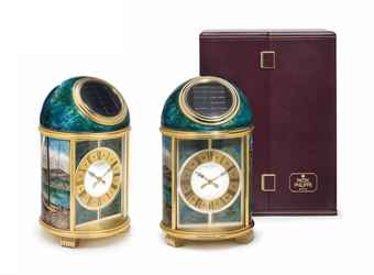 Patek Philippe. A Fine and Unique Gilt Brass Solar-Powered Desk Clock with Cloisonné Sail Boat Motif and Original Presentation Box