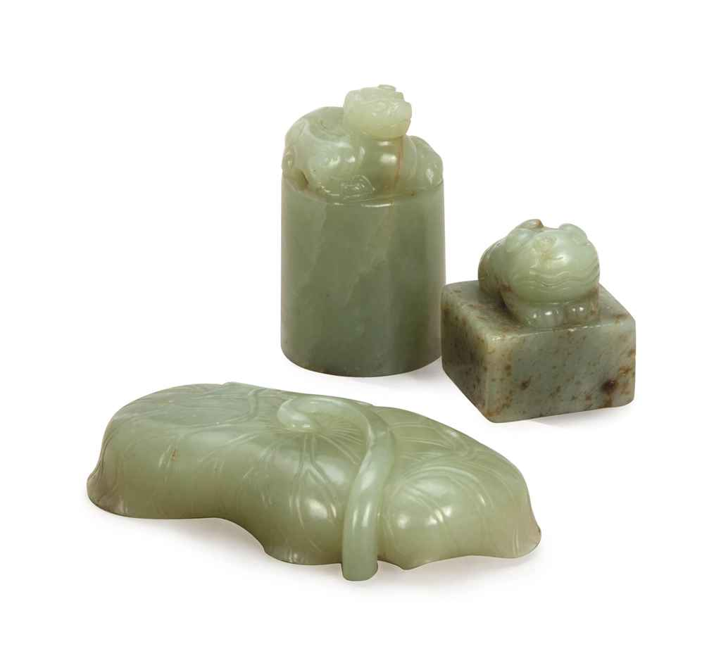 TWO CHINESE PALE GREYISH-GREEN JADE SEALS AND A PALE GREYISH...