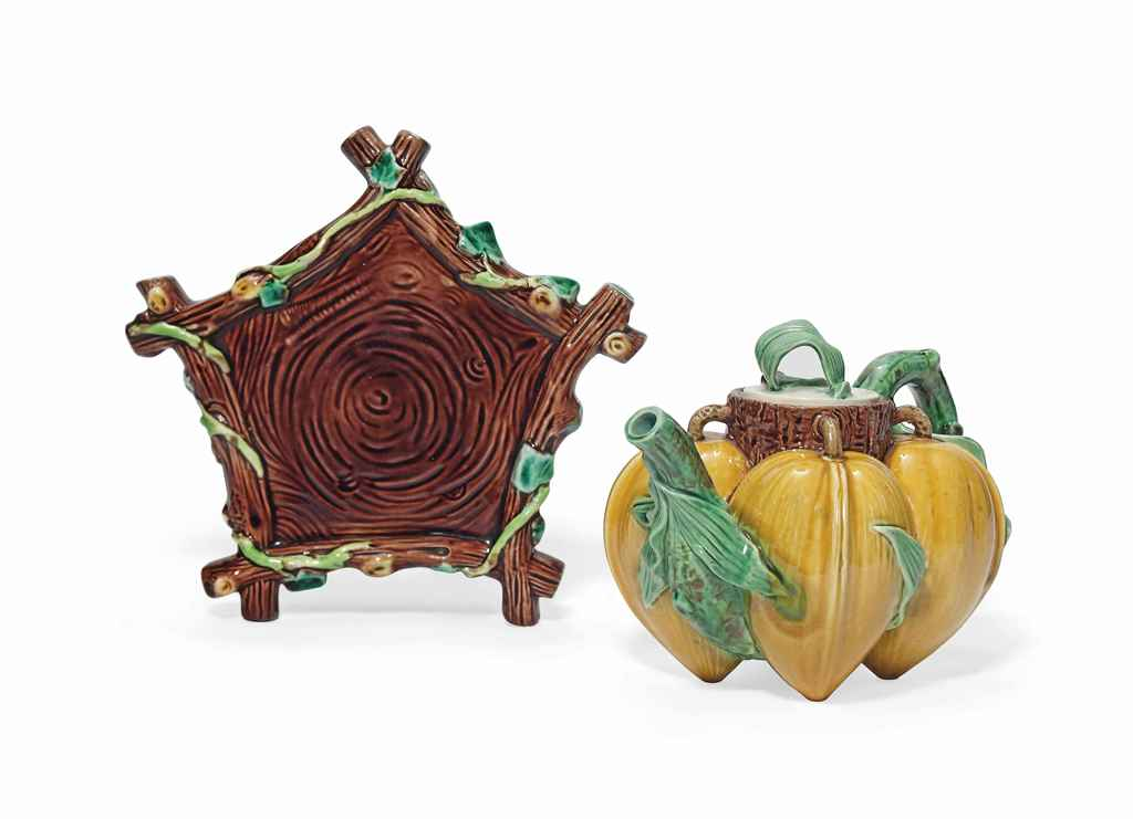 A MINTON MAJOLICA TEAPOT AND A GEORGE JONES MAJOLICA STAND ...