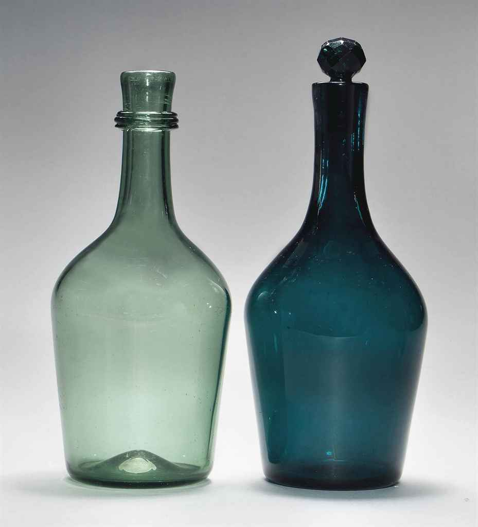 AN EMERALD-GREEN GLASS CLUB-SHAPED DECANTER AND STOPPER AND ...
