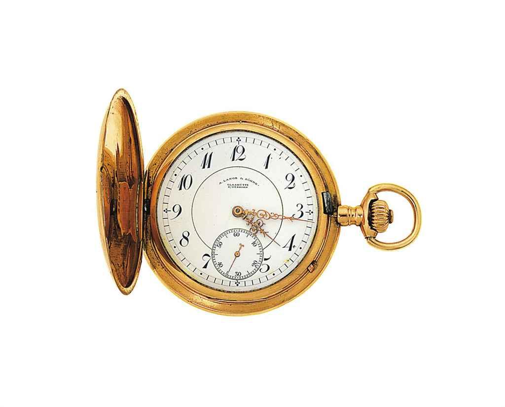 A gold pocket watch by Lange &