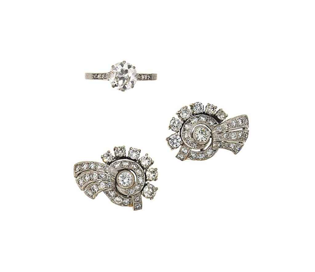 A diamond ring and pair of ear