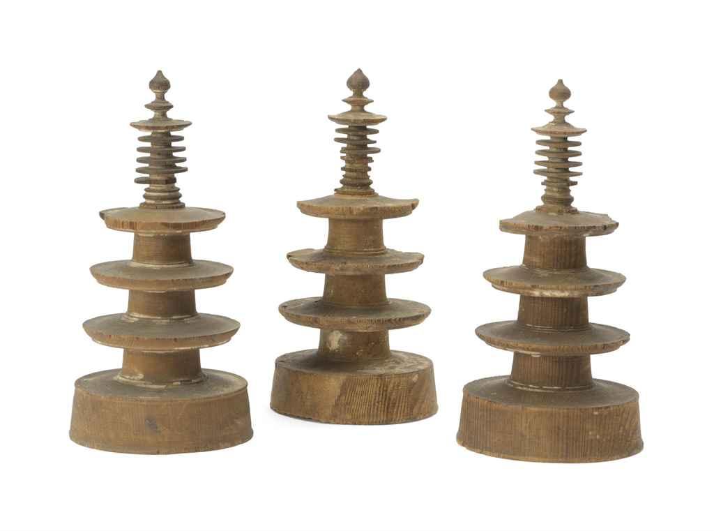 A set of three wood pagodas fr