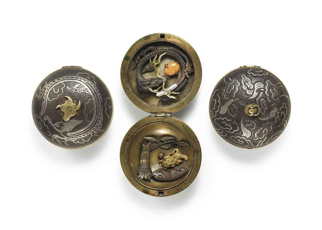 An inlaid mixed-metal netsuke