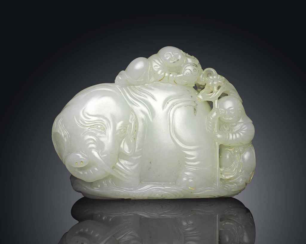 A WHITE JADE CARVING OF AN ELEPHANT WITH BOYS