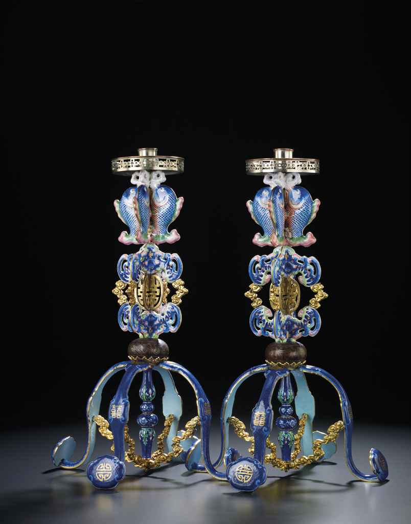 A LARGE PAIR OF CANTON ENAMEL CANDLESTICKS