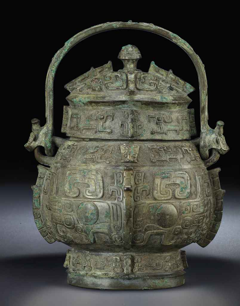 AN IMPORTANT AND VERY RARE ARCHAIC BRONZE WINE VESSEL, YOU ...