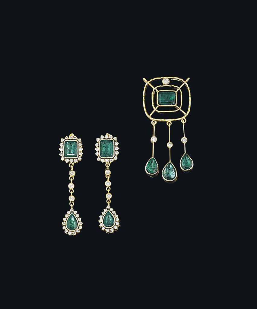 An emerald and diamond pendant and pair of earrings